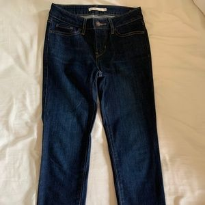 Levi Strauss dark wash jeans with frayed ends